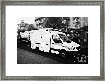 Dublin Fire Brigade Emergency Ambulance Speeds Along Oconnell Street Dublin Republic Of Ireland Framed Print by Joe Fox
