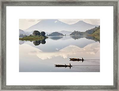 Dugout Canoe Floating On Lake Mutanda Framed Print