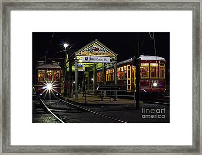 Dumaine St. Trolly In New Orleans Framed Print by Kent Taylor