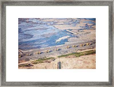 Dump Trucks At Tar Sand Mine Framed Print by Ashley Cooper