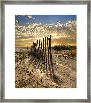 Dune Fence At Sunrise Framed Print by Debra and Dave Vanderlaan