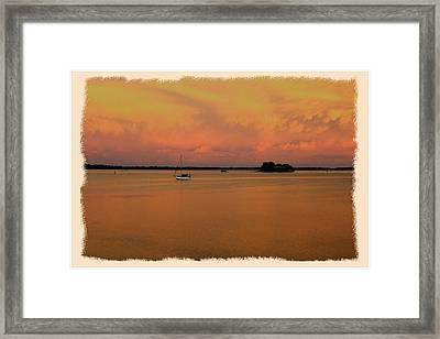 Dunedin Sunset Boat Framed Print by Wynn Davis-Shanks