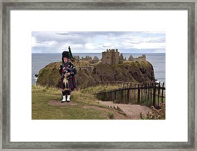 Dunnottar Piper Framed Print