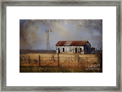 Dust In The Air Framed Print