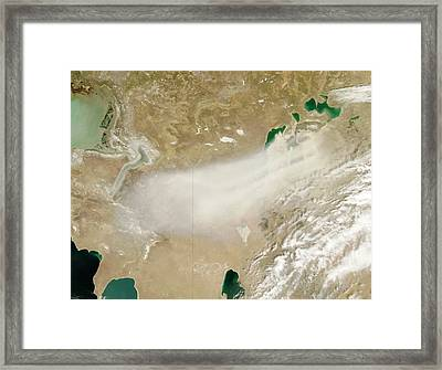 Dust Storm Over The Aral Sea Framed Print