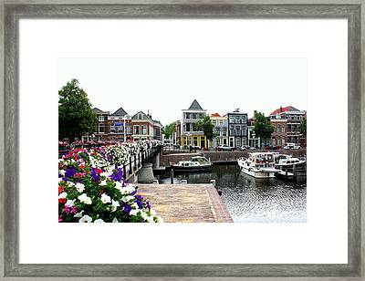 Dutch Cityscape With Boats Framed Print by Carol Groenen