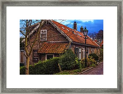 Dutch Village Framed Print by Jenny Rainbow