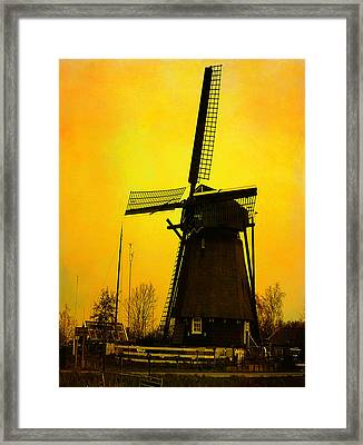Dutch Windmill - Yellow Framed Print by Yvon van der Wijk
