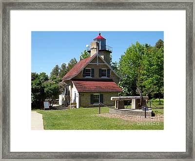 Eagle Bluff Lighthouse With Boat Anchor Framed Print by Deb Schense