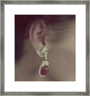 Ear Of A Model With A Ruby Earring Framed Print