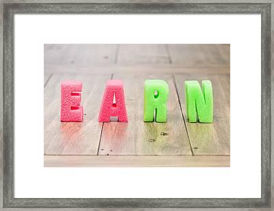 Earn Framed Print