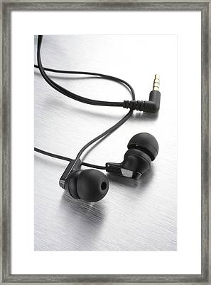 Earphones Using Neodymium Magnets Framed Print by Science Photo Library