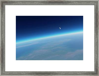 Earth's Atmosphere And Moon Framed Print