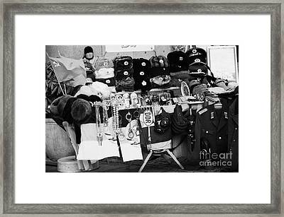 east german and russian memorabilia on sale at a street stall near checkpoint charlie Berlin Germany Framed Print