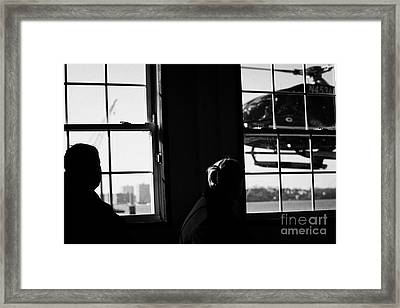 Ec130 American Eurocopter Comes In To Land Watched By Two Passengers New York Framed Print by Joe Fox