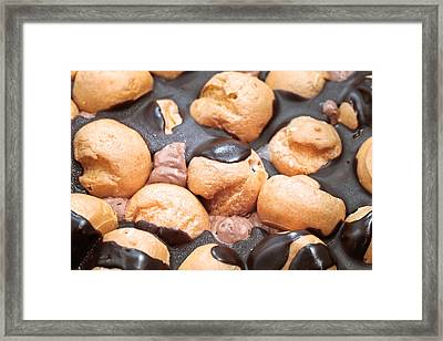 Eclair Cake Framed Print by Tom Gowanlock