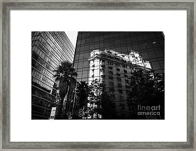 edificio ariztia building reflected in modern bank buildings in the financial district of Santiago Chile Framed Print by Joe Fox