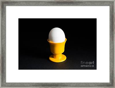Egg In Cup At Black Background Framed Print by Kennerth and Birgitta Kullman
