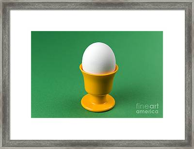 Egg In Cup At Green Background Framed Print by Kennerth and Birgitta Kullman