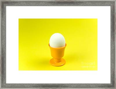 Egg In Cup At Yellow Background Framed Print by Kennerth and Birgitta Kullman