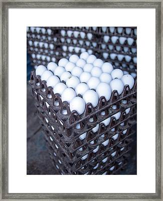 Eggs Get Stacked In Crates Framed Print by David H. Wells