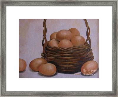 Eggs In A Basket Framed Print by Karen Olson