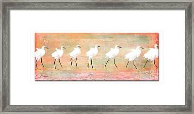 Egrets Flamingoed Framed Print by Jennie Breeze