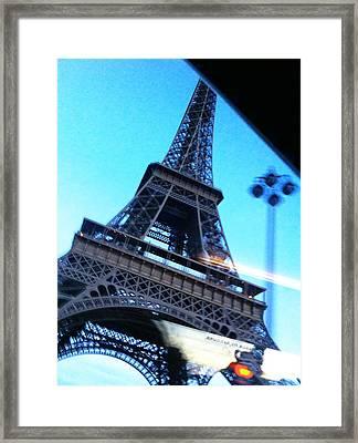 Eiffel In Motion Framed Print by Kathy Corday