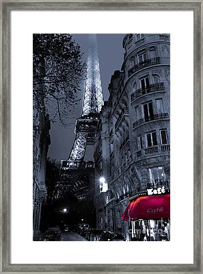Eiffel Tower From A Side Street Framed Print by Simon Kayne