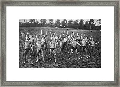 Eighteen Men Tossing Balls Framed Print by Underwood Archives
