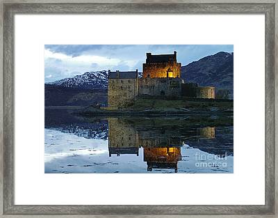 Eilean Donan Castle At Dusk Framed Print by Phil Banks