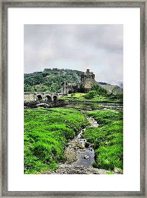 Eilean Donan Framed Print by Jacqi Elmslie
