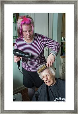 Elderly Lady Having Her Haircut Framed Print by Jim West
