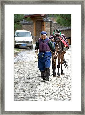 Elderly Naxi Woman With Her Horse Framed Print by Tony Camacho