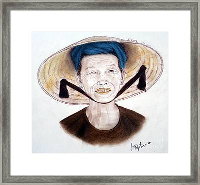 Elderly Vietnamese Woman Wearing A Conical Hat Framed Print by Jim Fitzpatrick