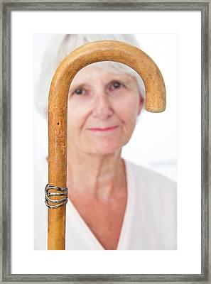 Elderly Woman And Walking Stick Framed Print