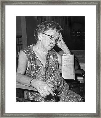 Elderly Woman At Hospital Framed Print by Underwood Archives