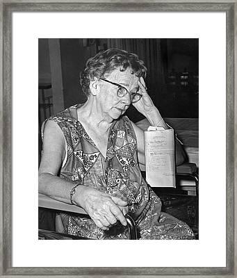 Elderly Woman At Hospital Framed Print
