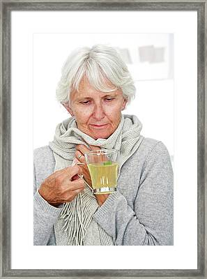 Elderly Woman Drinking Hot Lemon Framed Print by Lea Paterson