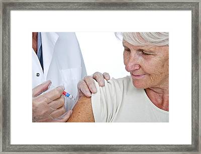 Elderly Woman Having An Injection Framed Print by Lea Paterson