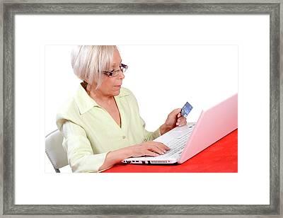 Elderly Woman Shopping Online Framed Print by Aj Photo