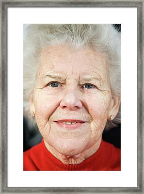 Elderly Woman Smiling Framed Print by Cristina Pedrazzini/science Photo Library