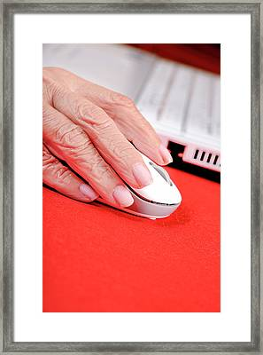 Elderly Woman Using A Computer Mouse Framed Print