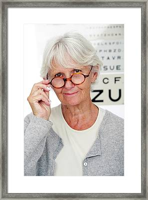 Elderly Woman Wearing Glasses Framed Print by Lea Paterson