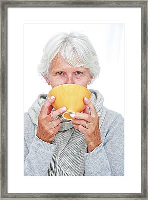 Elderly Woman With A Hot Drink Framed Print