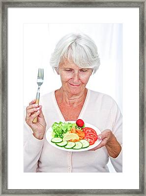 Elderly Woman With A Salad Framed Print by Lea Paterson