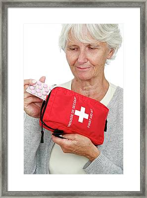 Elderly Woman With First Aid Kit Framed Print by Lea Paterson
