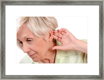 Elderly Woman With Hearing Loss Framed Print