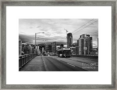 electric bus on granville street bridge over false creek Vancouver BC Canada Framed Print by Joe Fox