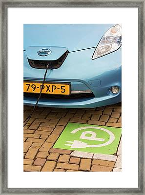 Electric Car At A Charging Station Framed Print by Ashley Cooper